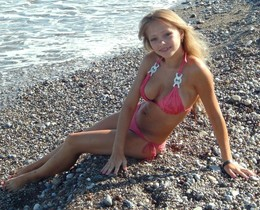 Cute blonde teen angel on the beach,..
